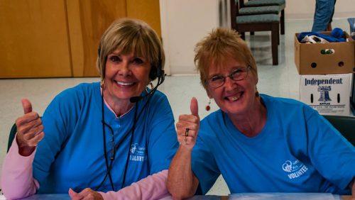 2 Women volunteers giving thumbs up