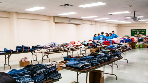 Clothes donations stacked on tables