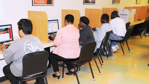 People sitting at computer lab